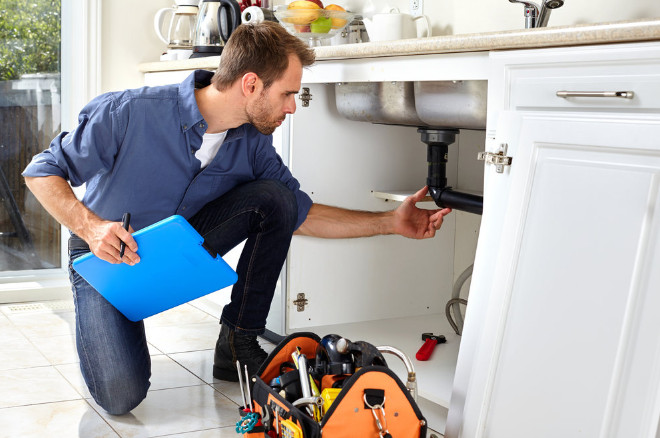 a plumber checking the plumging system in a home in Sydney